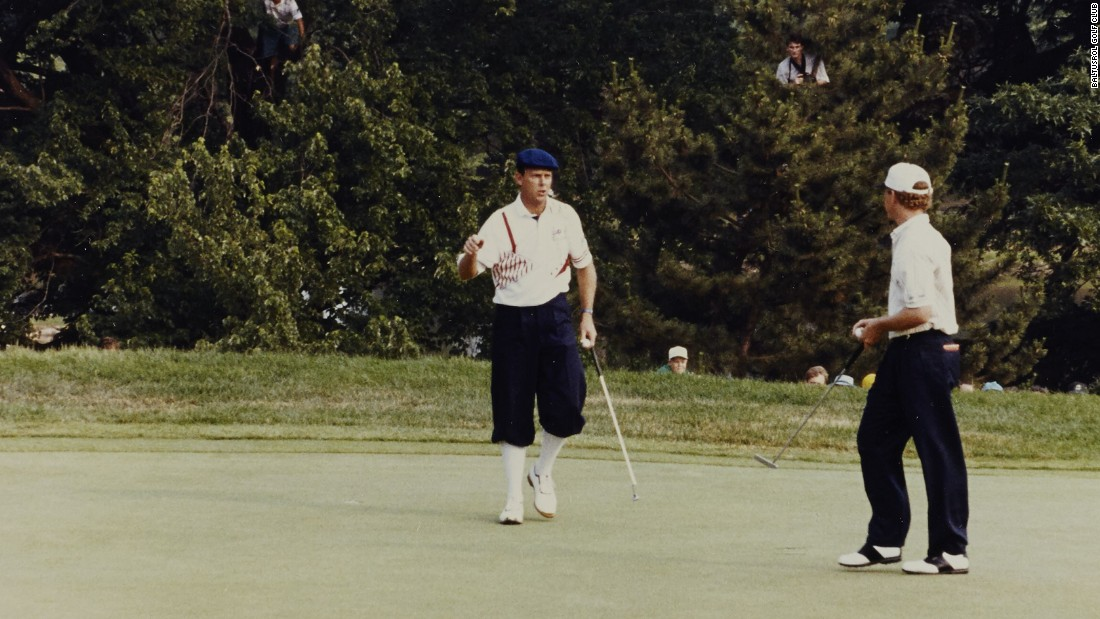 Baltusrol's next major was in 1993. Payne Stewart (left, sporting the colors of the Buffalo Bills NFL team) congratulates Lee Janzen -- who beat the 1991 champion by two shots to win the first of his two U.S. Opens, equaling Nicklaus' 1980 scoring record. Spot the photographers in the trees.