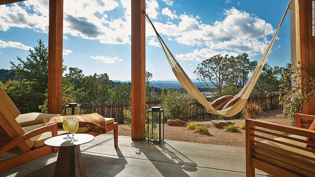 Located at the foothills of the Sangre de Cristo Mountains near Santa Fe, each casita-style dwelling at Four Seasons Resort Rancho Encantado is furnished with traditional decor (Native American rugs and pottery).