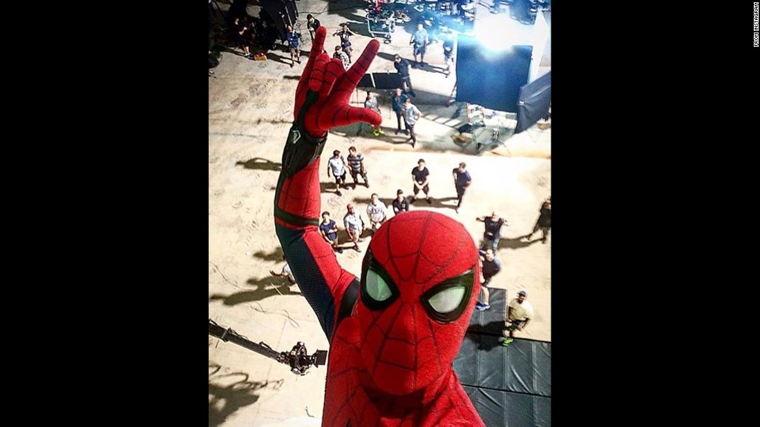 "Actor Tom Holland <a href=""https://www.instagram.com/p/BHk9CiRjeEr/?hl=en"" target=""_blank"">shares a selfie</a> he took on the set of ""Spider-Man: Homecoming"" on Thursday, July 7. He said the film would hit theaters in a year."