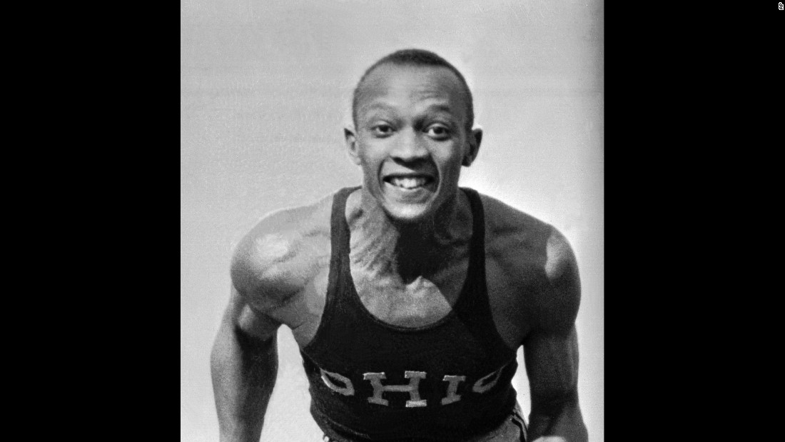 """Owens poses in his Ohio State track jersey in April 1935. His full name was James Cleveland (J.C.) Owens. He got the nickname Jesse from his first schoolteacher in Cleveland. She misunderstood Owens when he said J.C., and <a href=""""http://www.jesseowens.com/about/"""" target=""""_blank"""">she put his name down as Jesse.</a>"""