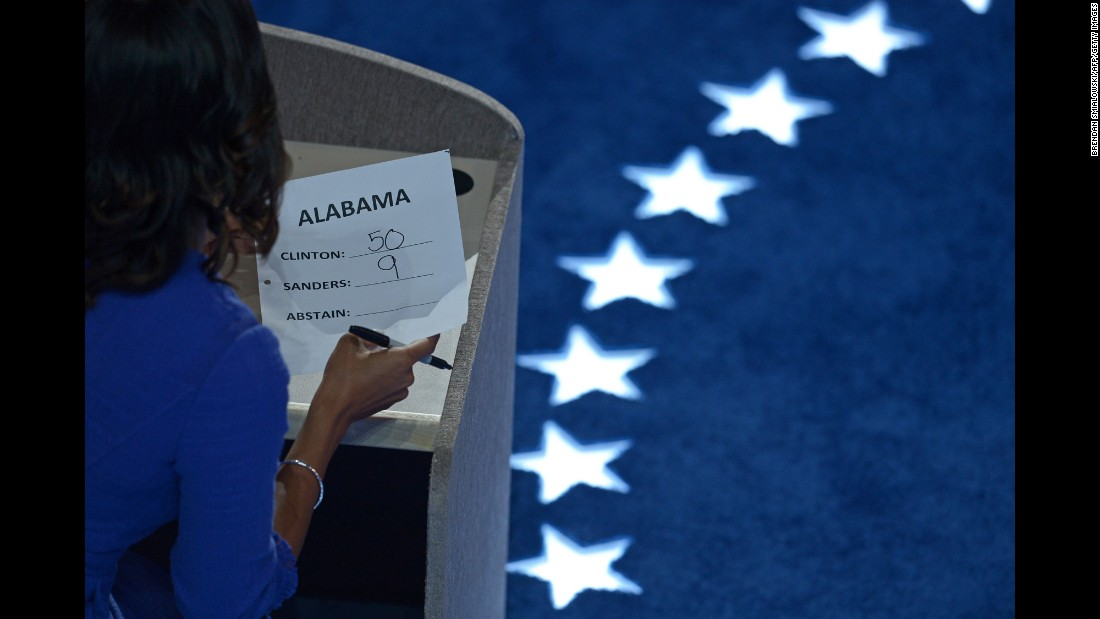A staff member tallies Alabama's votes during roll call on Tuesday.