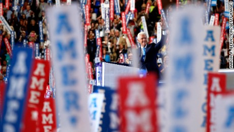 Former US President Bill Clinton waves to the crowd as he arrives on stage to deliver remarks on the second day of the Democratic National Convention at the Wells Fargo Center, July 26, 2016 in Philadelphia, Pennsylvania. Democratic presidential candidate Hillary Clinton received the number of votes needed to secure the party's nomination. An estimated 50,000 people are expected in Philadelphia, including hundreds of protesters and members of the media. The four-day Democratic National Convention kicked off July 25.