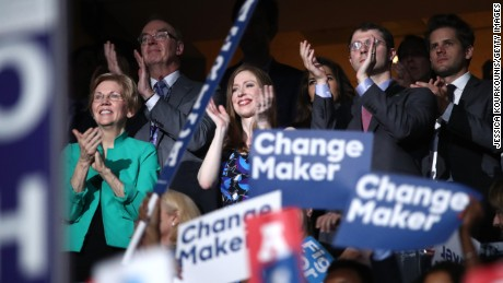 Sen. Elizabeth Warren (D-MA), Chelsea Clinton and husband Marc Mezvinsky applaud former US President Bill Clinton on the second day of the Democratic National Convention at the Wells Fargo Center, July 26, 2016 in Philadelphia, Pennsylvania. Democratic presidential candidate Hillary Clinton received the number of votes needed to secure the party's nomination. An estimated 50,000 people are expected in Philadelphia, including hundreds of protesters and members of the media. The four-day Democratic National Convention kicked off July 25. (Photo by Jessica Kourkounis/Getty Images)