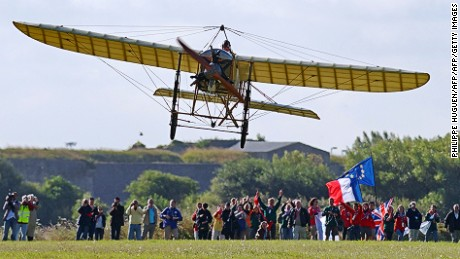 Frenchman Edmond Salis flies a restored Bleriot XI in July 2009 to mark the 100th anniversary of Louis Bleriot's historic crossing.