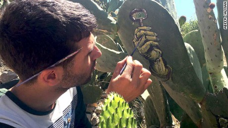 Artist Ahmad Muhammad Yasin expresses his views via his depictions on cactus plants.