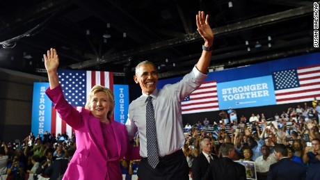 President Barack Obama and Democratic presidential candidate Hillary Clinton wave following a campaign event at the Charlotte Convention Center in Charlotte, N.C., Tuesday, July 5, 2016. Obama is spending the afternoon campaigning for Clinton.