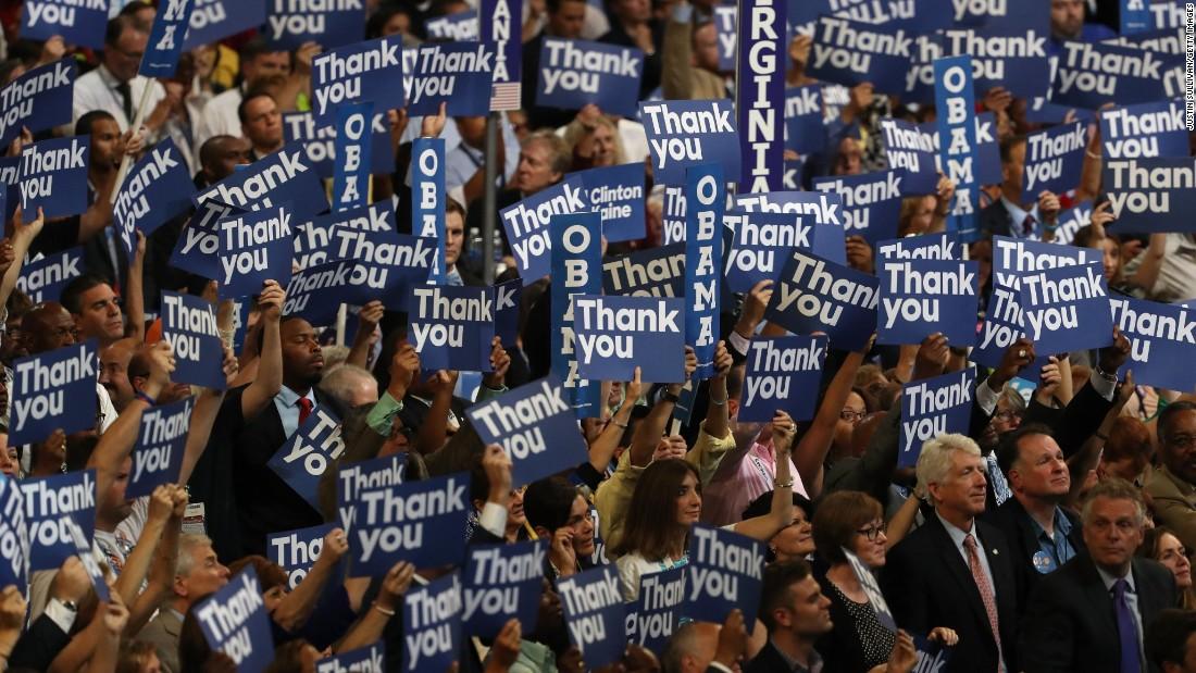 Delegates stand as Obama speaks.