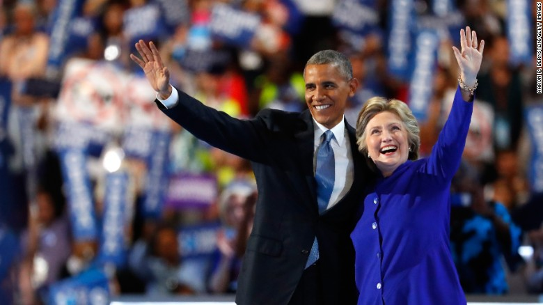 U.S. President Barack Obama and Democratic presidential nominee Hillary Clinton wave to the crowd Wednesday after Obama spoke at the Democratic National Convention in Philadelphia.