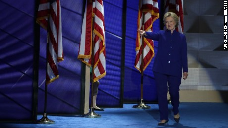 Democratic presidential candidate Hillary Clinton arrives on stage after US President Barack Obama delivered a speech on the third day of the Democratic National Convention at the Wells Fargo Center, July 27, 2016 in Philadelphia, Pennsylvania. Democratic presidential candidate Hillary Clinton received the number of votes needed to secure the party's nomination. An estimated 50,000 people are expected in Philadelphia, including hundreds of protesters and members of the media. The four-day Democratic National Convention kicked off July 25.