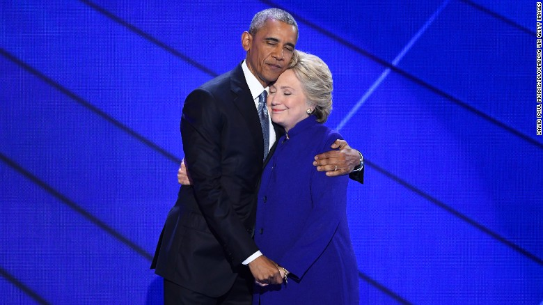 Obama and Clinton hug at the Democratic National Convention