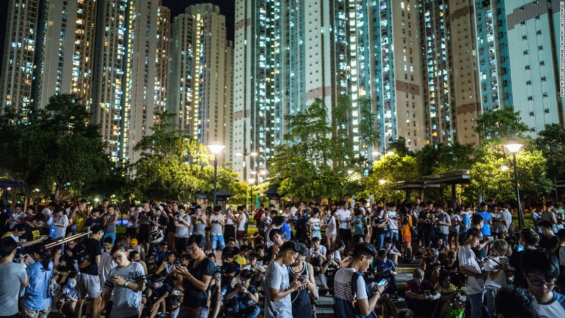 People play Pokémon GO at a park in Tin Shui Wai on July 26, 2016 in Hong Kong.