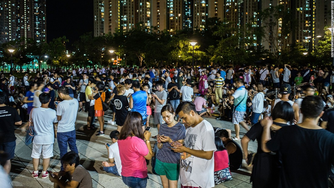 """Since the game's release, hundreds have flocked to Hong Kong's already busy streets and public places, leading some to complain of smartphone """"zombies."""""""