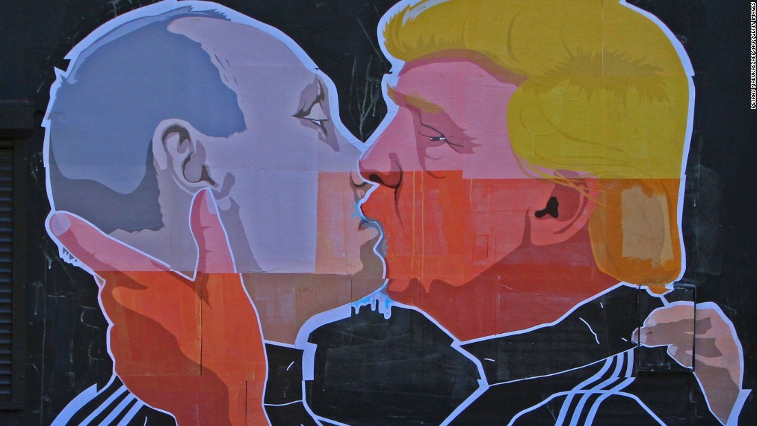 A mural of US presidential nominee Donald Trump and Russian President Vladimir Putin is painted on a wall in the Lithuanian capital of Vilnius.