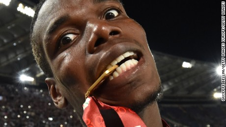 ROME, ITALY - MAY 21:  Paul Pogba of Juventus FC celebrates the victory after the TIM Cup match between AC Milan and Juventus FC at Stadio Olimpico on May 21, 2016 in Rome, Italy.  (Photo by Giuseppe Bellini/Getty Images)