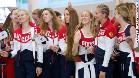 Russian Olympic team members attend a farewell ceremony for the Rio Games at Moscow's Sheremetyevo airport on July 28, 2016.