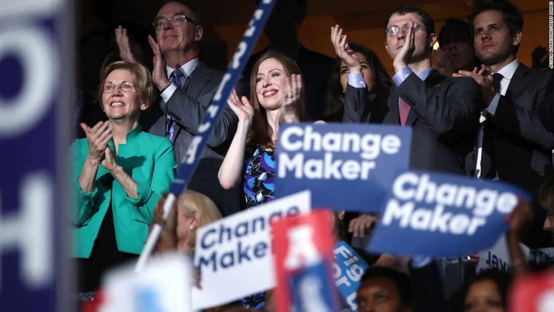 Chelsea applauds her father as he speaks  at the Democratic National Convention.