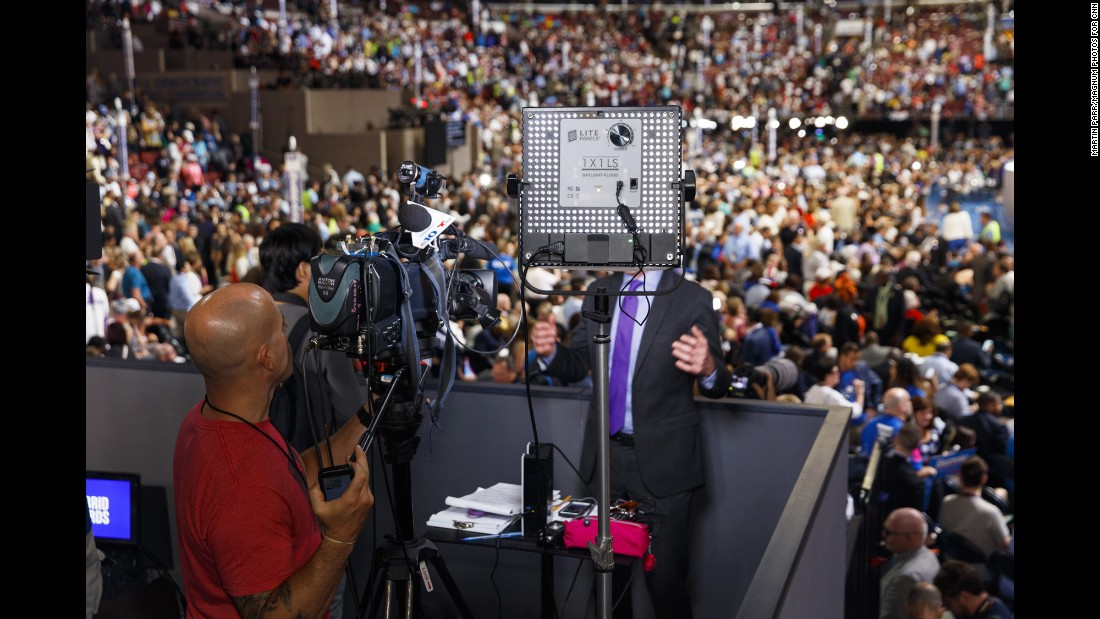 NBC 10 Philadelphia broadcasts from a press stand above the floor of the Democratic National Convention.