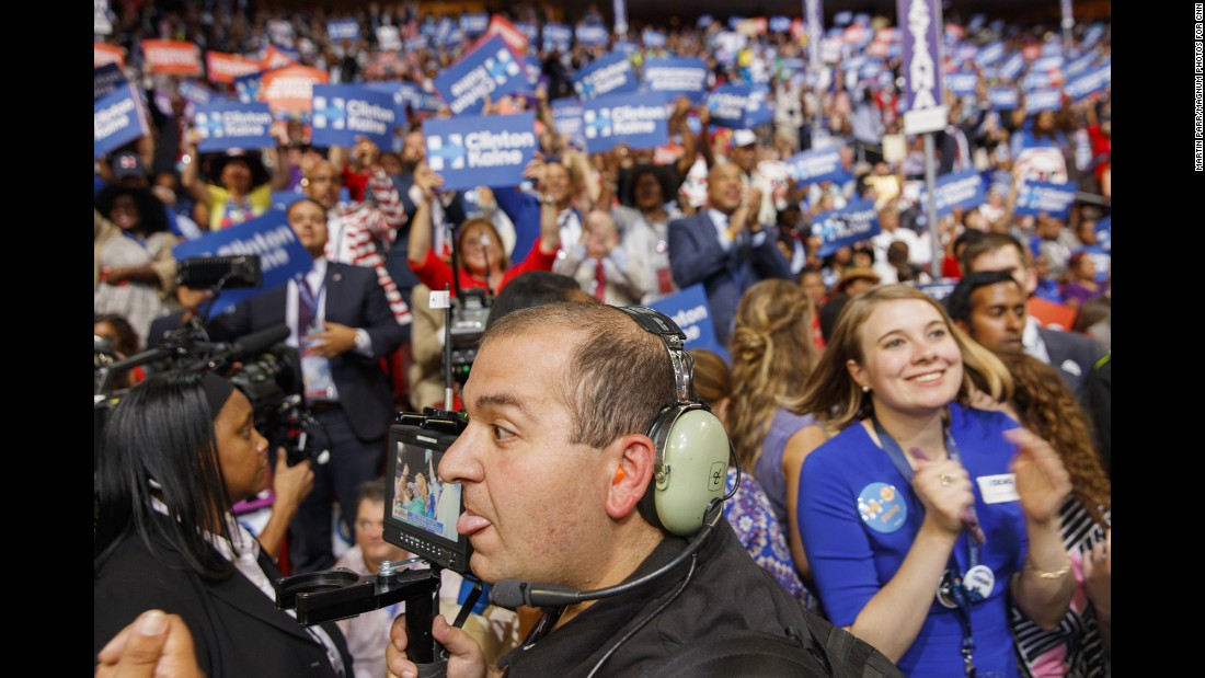 Media members film Hillary Clinton supporters on the convention floor.