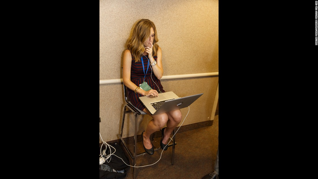 A woman works outside one of the broadcast network suites.