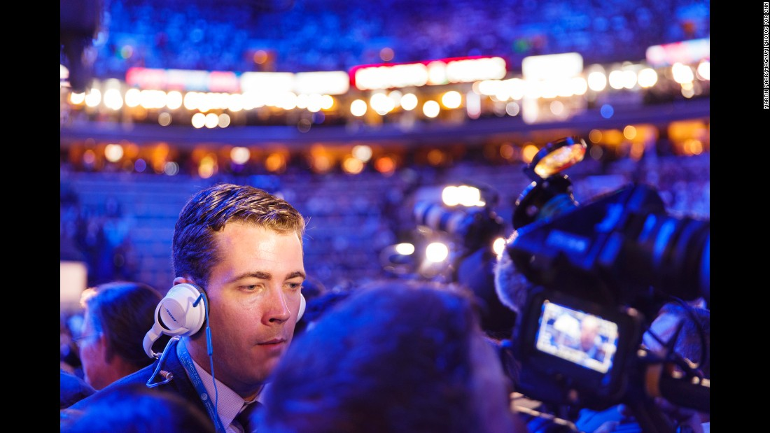 A broadcast journalist works inside the arena.
