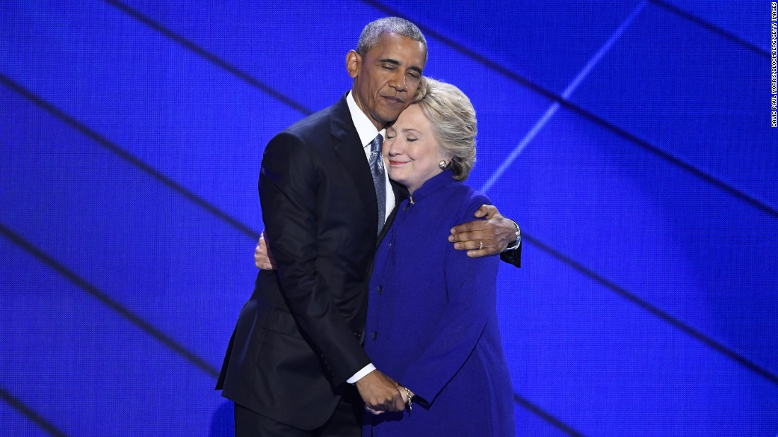 """U.S. President Barack Obama hugs Hillary Clinton after he gave a speech Wednesday, July 27, at the <a href=""""http://www.cnn.com/2016/07/25/politics/gallery/democratic-convention/index.html"""" target=""""_blank"""">Democratic National Convention</a> in Philadelphia. Obama said Clinton, the Democratic Party's presidential nominee, is ready to be commander in chief. """"For four years, I had a front-row seat to her intelligence, her judgment and her discipline,"""" he said, referring to Clinton's stint as secretary of state."""