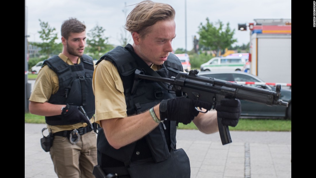 """Armed police arrive to the scene of a deadly shooting in Munich, Germany, on Friday, July 22. At least nine people were killed and 35 were injured <a href=""""http://www.cnn.com/2016/07/24/europe/germany-munich-shooting/"""" target=""""_blank"""">when an 18-year-old opened fire</a> at a popular shopping mall."""