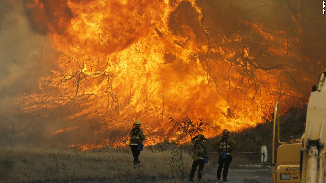 """A hillside erupts in flames as a raging wildfire fire burns in Santa Clarita, California, on Monday, July 25. The Sand Fire <a href=""""http://www.cnn.com/2016/07/26/us/california-wildfires/"""" target=""""_blank"""">has forced thousands from their homes</a> on the edge of Los Angeles."""