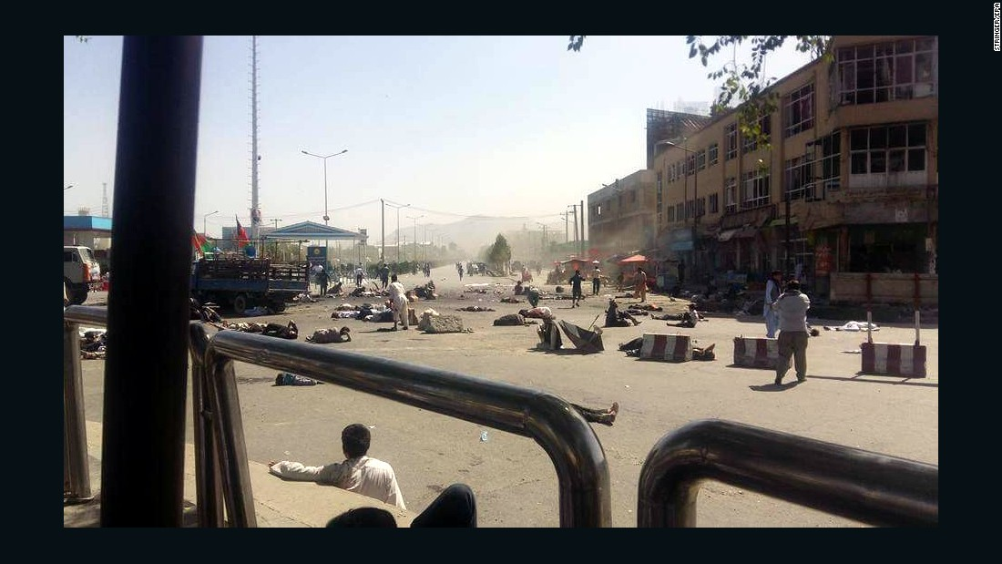 """Injured people lie on the ground after a bomb exploded during a peaceful demonstration in Kabul, Afghanistan, on Saturday, July 23. <a href=""""http://www.cnn.com/2016/07/23/asia/afghanistan-explosion/"""" target=""""_blank"""">ISIS claimed responsibility</a> for a joint suicide bombing that killed dozens of people and wounded more than 260."""