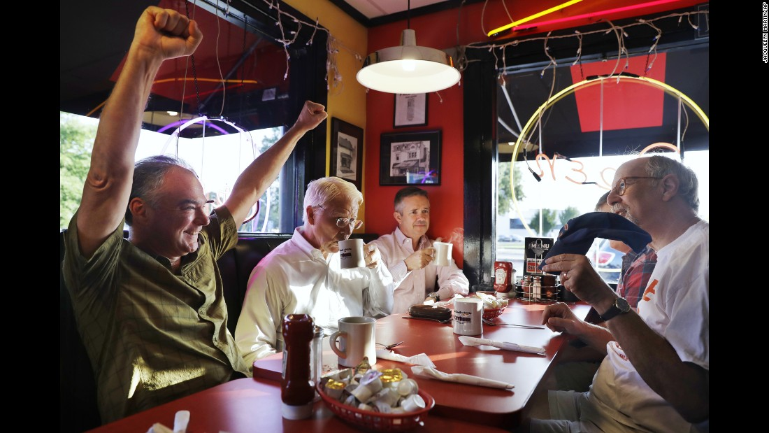 """U.S. Sen. Tim Kaine, left, talks sports with friends during breakfast in Richmond, Virginia, on Tuesday, July 26. Kaine had recently been named <a href=""""http://www.cnn.com/2016/07/22/politics/hillary-clinton-vp-pick/"""" target=""""_blank"""">Hillary Clinton's running mate</a> on the Democratic ticket."""