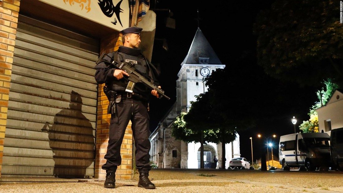 """A police officer guards a street in the French town of Saint-Etienne-du-Rouvray after an attack left a priest dead on Tuesday, July 26. French President Francois Hollande said <a href=""""http://www.cnn.com/2016/07/26/europe/france-normandy-church-hostage/"""" target=""""_blank"""">the attack</a> was a """"cowardly assassination"""" carried out by two terrorists in the name of ISIS."""