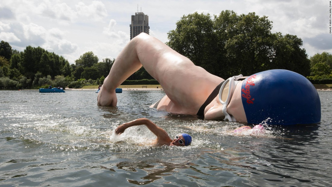 """George Cselko swims past a sculpture of British swimming champion Rebecca Adlington after it was unveiled in London's Hyde Park on Monday, July 25. The sculpture is part of a campaign to encourage support for Great Britain's Olympic athletes. <a href=""""http://www.cnn.com/2016/07/22/world/gallery/week-in-photos-0722/index.html"""" target=""""_blank"""">See last week in 33 photos</a>"""