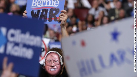 PHILADELPHIA, PA - JULY 27: A delegate wears a Sen. Bernie Sanders mask on the third day of the Democratic National Convention at the Wells Fargo Center, July 27, 2016 in Philadelphia, Pennsylvania. Democratic presidential candidate Hillary Clinton received the number of votes needed to secure the party's nomination. An estimated 50,000 people are expected in Philadelphia, including hundreds of protesters and members of the media. The four-day Democratic National Convention kicked off July 25. (Photo by Chip Somodevilla/Getty Images)