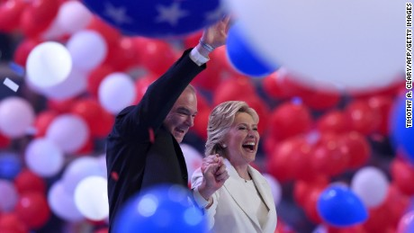 Presidential nominee Hillary Clinton (R) holds hands with Vice Presidential candidate Tim Kaine after the fourth and final day of the Democratic National Convention on July 28, 2016 in Philadelphia, Pennsylvania.