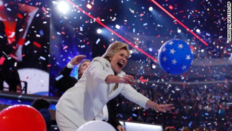 Democratic presidential nominee Hillary Clinton throws a balloon after addressing the delegates during the final day of the Democratic National Convention in Philadelphia, Thursday, July 28, 2016. (AP Photo/Carolyn Kaster)