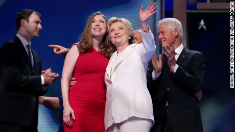Hillary Clinton, 2016 Democratic presidential nominee, center right, waves while standing with her daughter Chelsea Clinton during the Democratic National Convention (DNC) in Philadelphia, Pennsylvania, U.S., on Thursday, July 28, 2016. Division among Democrats has been overcome through speeches from two presidents, another first lady and a vice-president, who raised the stakes for their candidate by warning that her opponent posed an unprecedented threat to American diplomacy. Photographer: Daniel Acker/Bloomberg via Getty Images