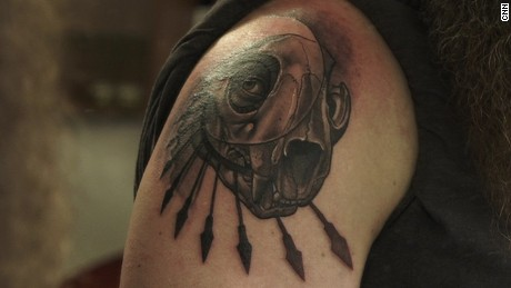 Tattoo work by Rasty Knayles, inspired by tribal animal designs.