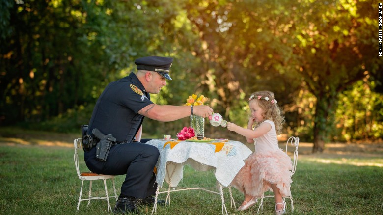 Officer joins little girl he saved in a tea party