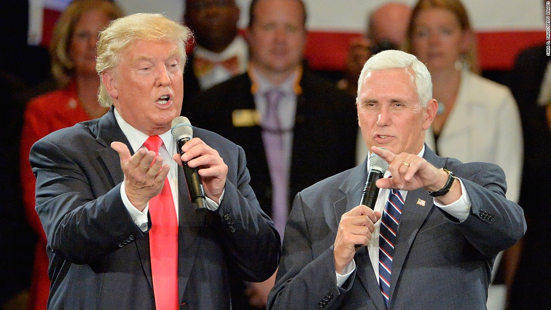 Republican presidential nominee Donald Trump, left, takes questions along with his running mate, Indiana Gov. Mike Pence, during a town hall campaign stop in Roanoke, Virginia, on Monday, July 25.