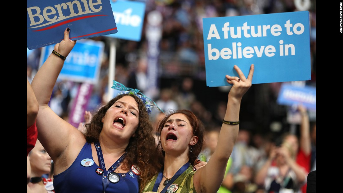 Supporters of U.S. Sen. Bernie Sanders cheer as he speaks at the Democratic National Convention on Monday, July 25. Sanders urged his supporters to vote for Hillary Clinton in November.