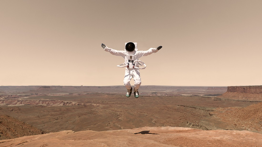 The artist combines the unknown Mars landscape with familiar vacation photography. <br />
