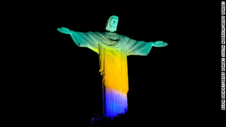 RIO DE JANEIRO, BRAZIL - AUGUST 05: View of the Christ The Redeemer Lit Green Yellow and Blue Two Years Ahead Of Rio 2016 Olympics Opening Ceremony on August 5, 2014 in Rio de Janeiro, Brazil.  (Photo by Buda Mendes/Getty Images)