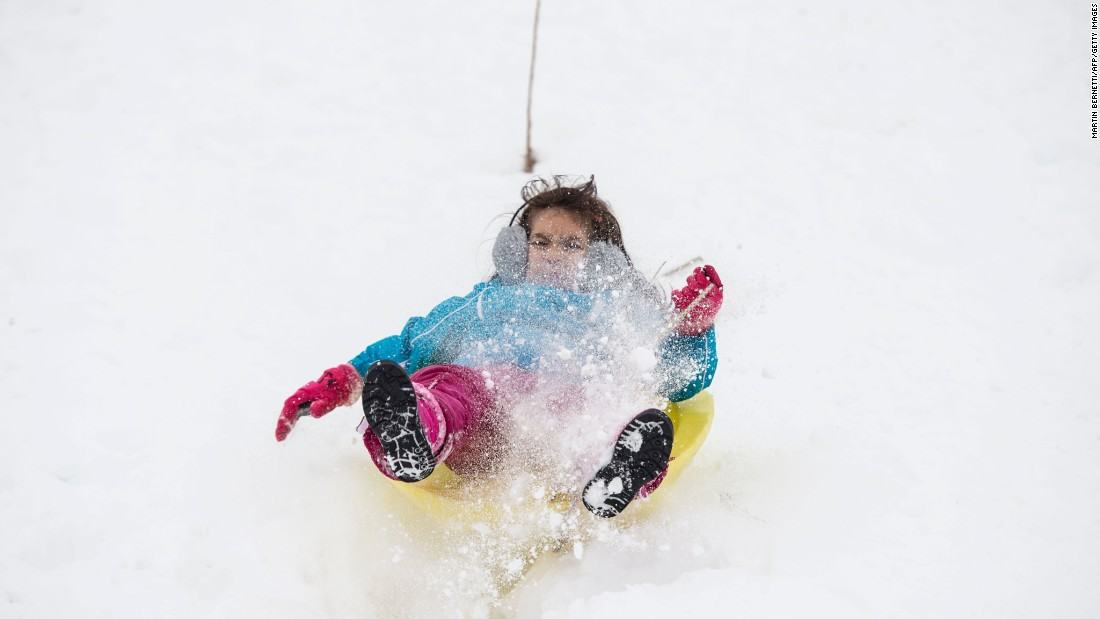 A child plays on a sled at a ski resort in Cajon del Maipo, Chile, on Tuesday, July 19.