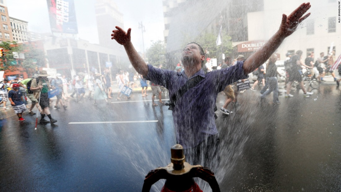 A supporter of U.S. Sen. Bernie Sanders cools off during a march in downtown Philadelphia on Sunday, July 24, ahead of the Democratic National Convention.