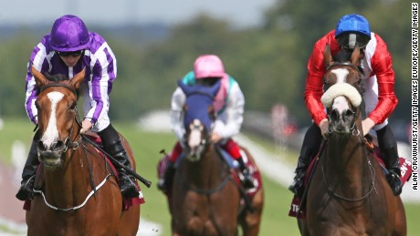 Ryan Moore rides Minding (L) to victory at the Nassau Stakes at Goodwood.