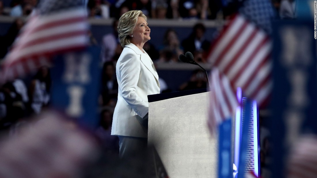 "Hillary Clinton, the Democratic Party's presidential nominee, arrives on stage to deliver her speech during the <a href=""http://www.cnn.com/2016/07/25/politics/gallery/democratic-convention/index.html"" target=""_blank"">Democratic National Convention</a> on Thursday, July 28.  <a href=""http://www.cnn.com/2016/07/29/politics/cnnphotos-behind-the-scenes-hillary-clinton-dnc/index.html"" target=""_blank"">Exclusive: Behind-the-scenes moments with Hillary Clinton</a>"