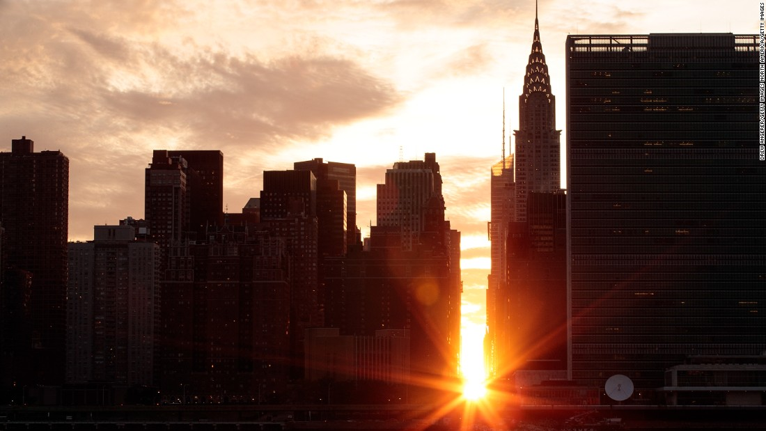 """A view of a <a href=""""http://www.cnn.com/2016/07/12/us/manhattanhenge-sun-new-york-irpt/index.html"""" target=""""_blank"""">""""Manhattanhenge"""" sunset</a> on Monday, July 11. """"Manhattanhenge"""" occurs when the lowering sun aligns perfectly with New York's east-west streets to create a glowing ball of light in between buildings."""