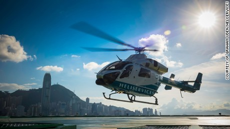Heliservices' chopper takes off from The Peninsula Hong Kong, the oldest luxury hotel in town.