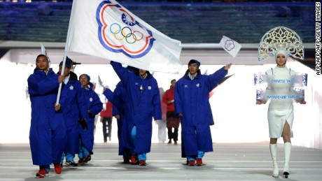 Taiwan's flag bearer, speed skater Sung Ching-Yang leads his national delegation during the Opening Ceremony of the Sochi Winter Olympics at the Fisht Olympic Stadium on February 7, 2014 in Sochi.  AFP PHOTO / ANDREJ ISAKOVIC        (Photo credit should read ANDREJ ISAKOVIC/AFP/Getty Images)