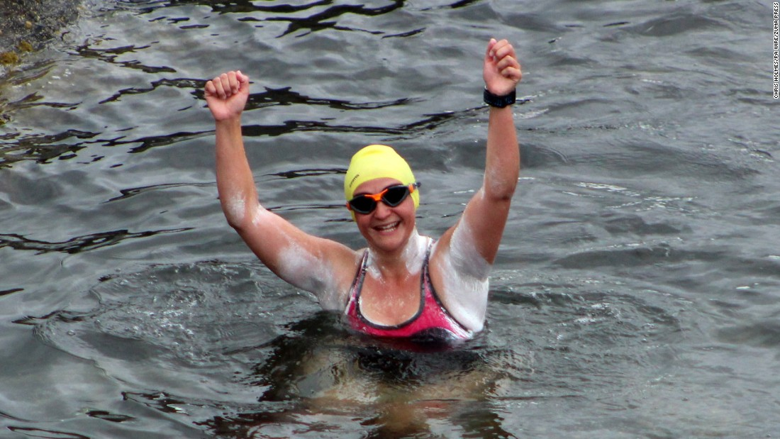 "Heather Clatworthy celebrates Wednesday, July 27, after she became the first swimmer in nearly 90 years to cross a 13-mile stretch of sea off Ireland's north coast. She <a href=""https://www.swimmingworldmagazine.com/news/heather-clatworthy-becomes-first-to-swim-moville-to-portstewart-since-1929/"" target=""_blank"">swam from Moville to Portstewart</a> in four hours and 15 minutes."