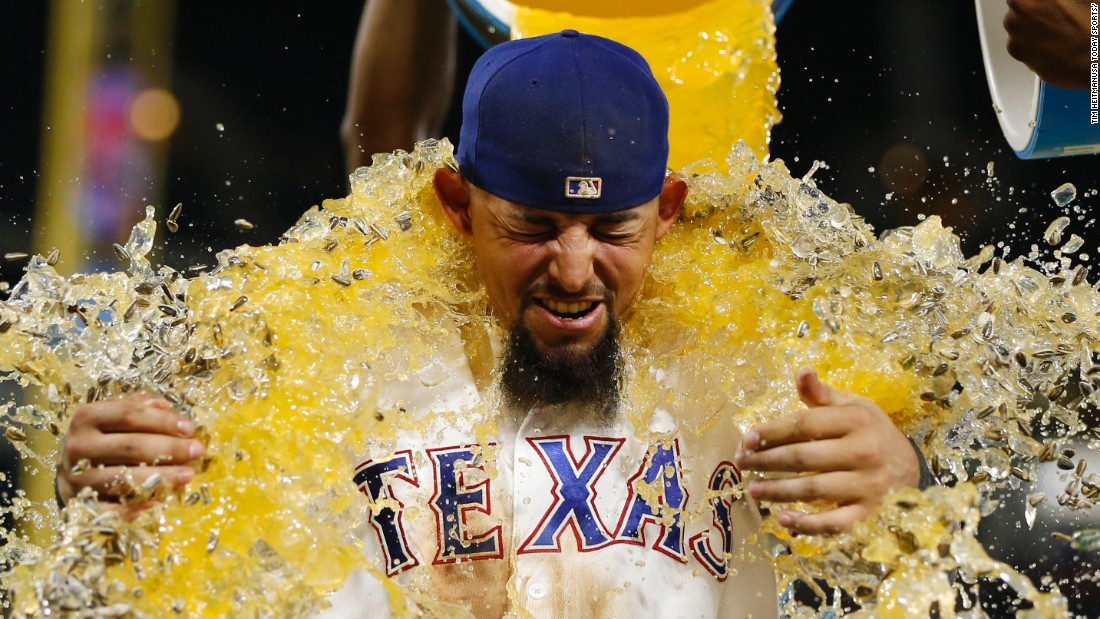 Rougned Odor is doused by his Texas Rangers teammates after a home win over Kansas City on Friday, July 29. Odor had two home runs in the 8-3 victory.